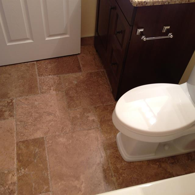 Bathroom with new tavertine flooring