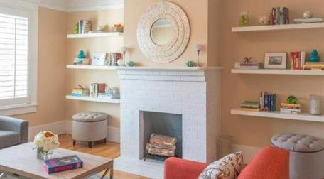 white and peach living space with white fireplace